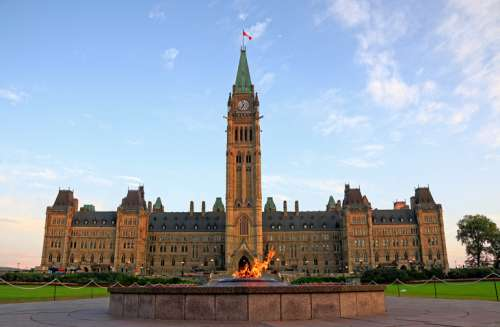 Parliament Buildings with Centennial flame in foreground, Ottawa, Canada