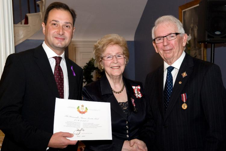 Hon. Marion L. Reid is presented with the Order of PEI at Government House by Premier Robert Ghiz and His Honor Frank Lewis