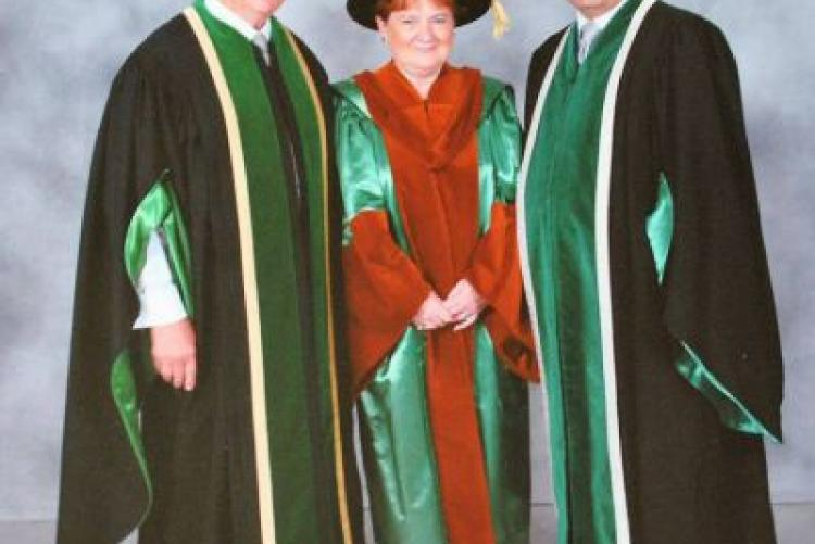 Pat Mella (centre) with her brother Don McDougall (left) and UPEI President Alaa Abd-El-Aziz