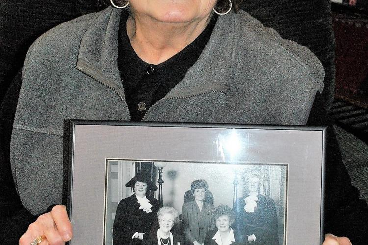 Nancy Guptill holds the PEI Famous 5 image