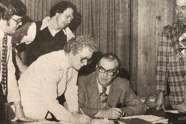 Black and white image of Marion Reid signing her nomination papers