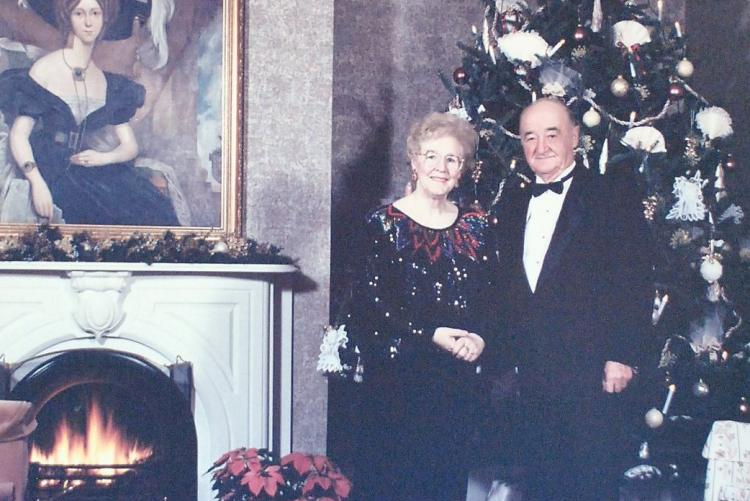 Hon. Marion L. Reid as Lieutenant Governor and her husband Lea Reid in the parlour at Government House at Christmas