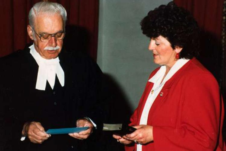 Nancy Guptill at a swearing-in ceremony with Chief Justice ?