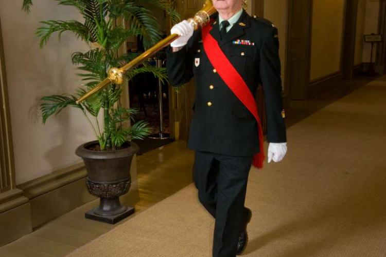 The Sergeant-at-Arms carries the mace into the Legislative chamber
