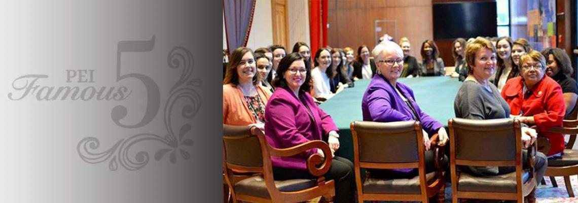 Group of PEI women sitting at a table in the historic Legislative Chamber